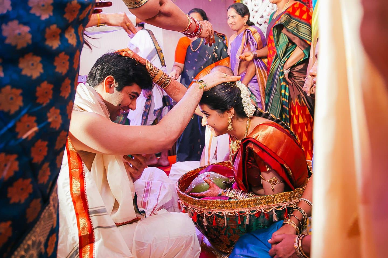 Bride and groom enjoying moments at hindu wedding