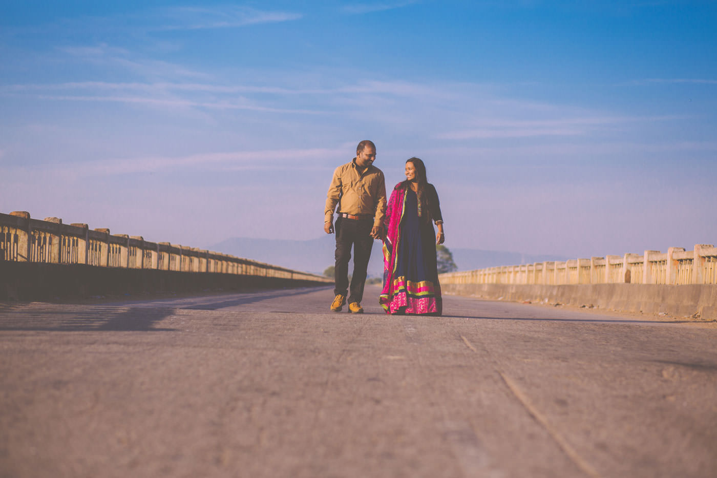 pre wedding couple session shot on a bridge