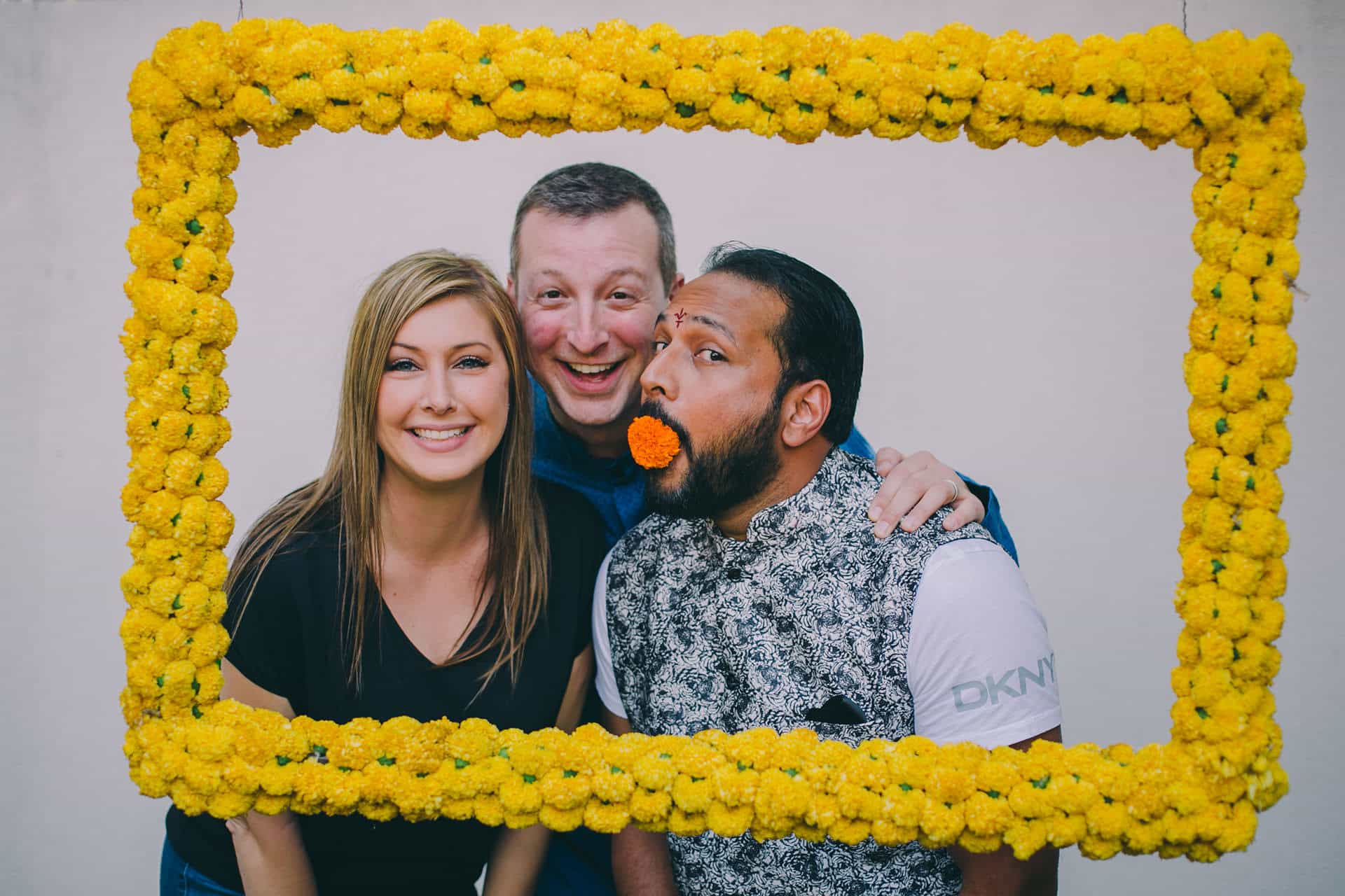 Candid moments at photo booth with groom and his close friends