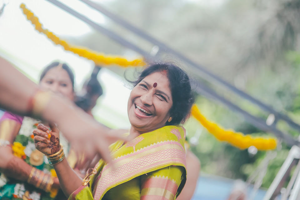 bride mom enjoying her moments in a South Indian Wedding Photography