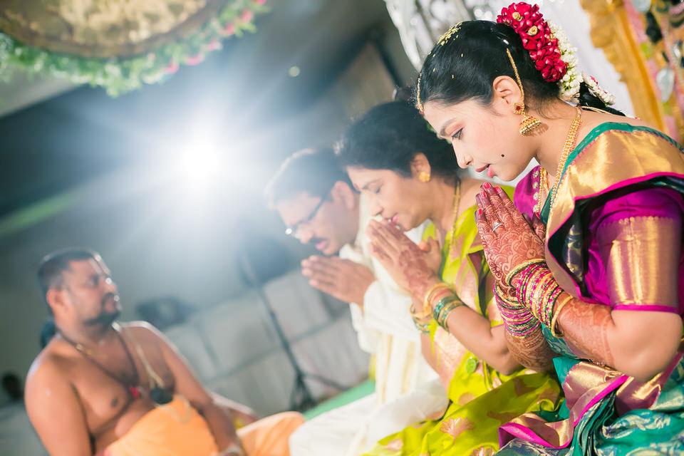 bride pooja during wedding