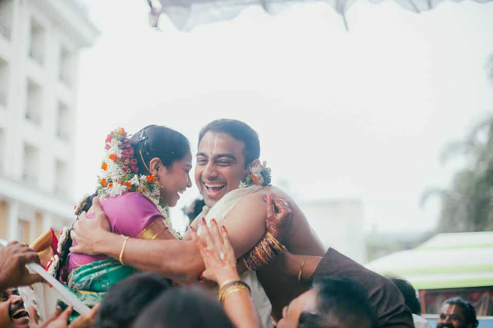 candid moment of bride and groom during endurukodalu in a South Indian Wedding