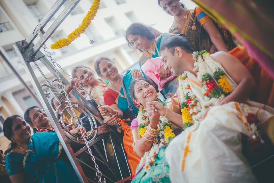 bride and groom enjoying the traditional south indian wedding
