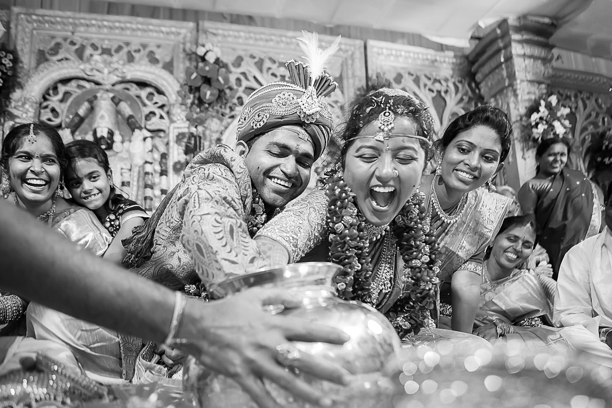 Groom and Bride fighting for their ring in hindu wedding ritual