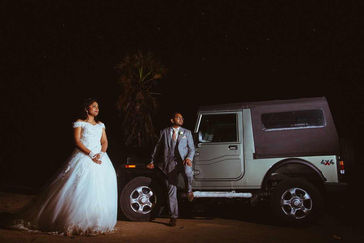 bride and groom with thar jeep in a wedding couples session