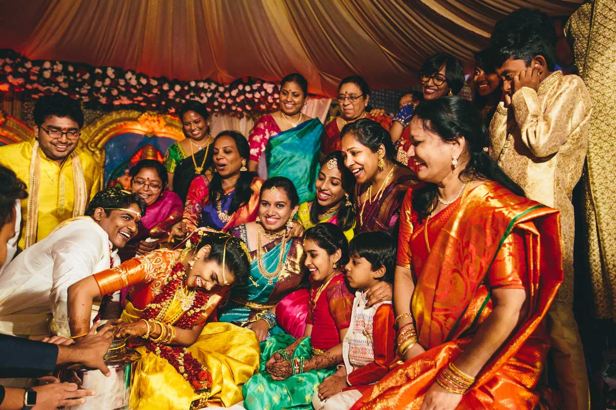 bride groom and whole family enjoying the games at Telugu Hindu wedding
