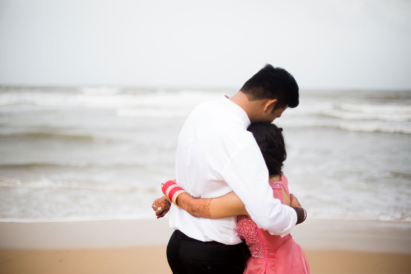 couple holding each other on the beach
