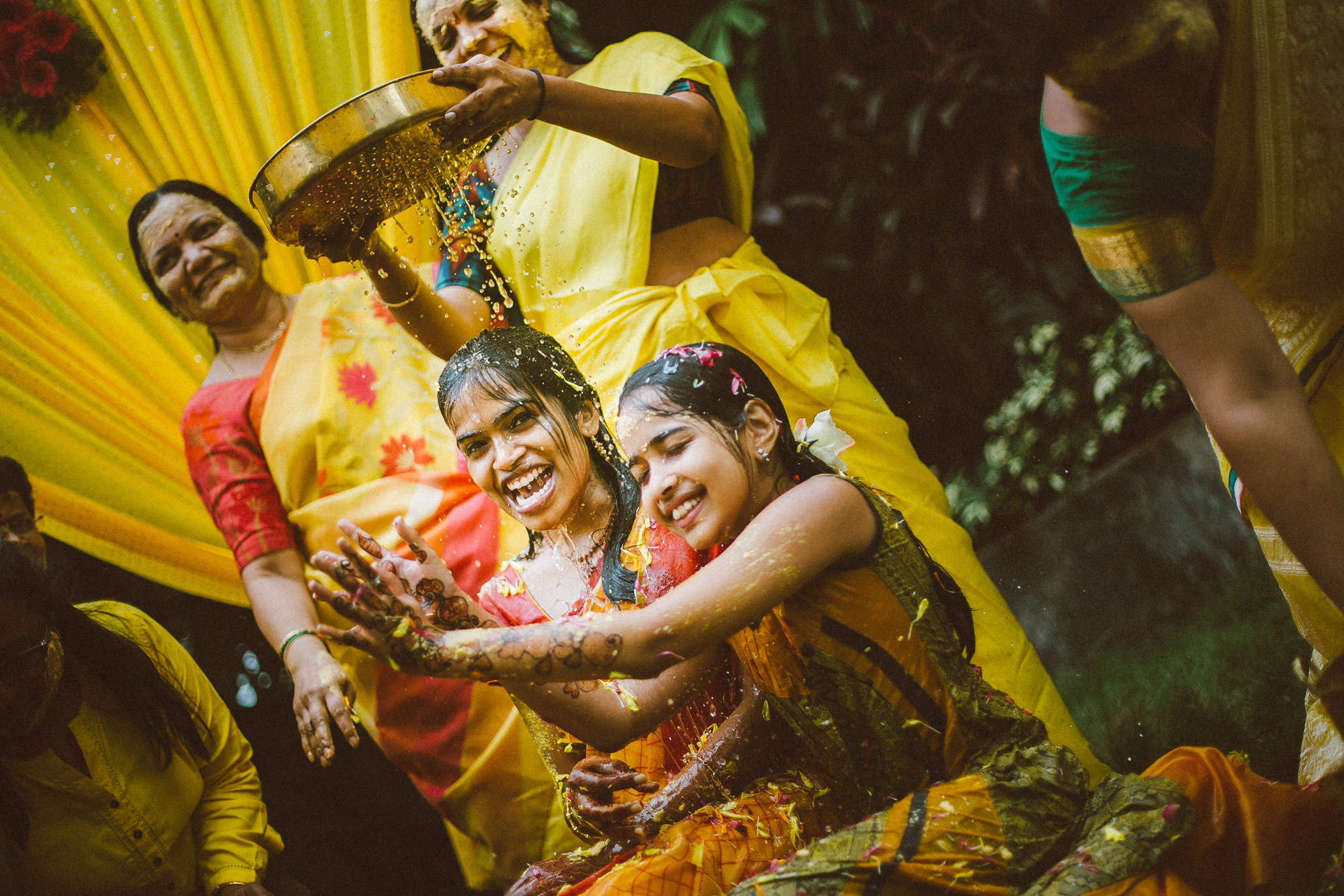 joyful bride enjoying haldi