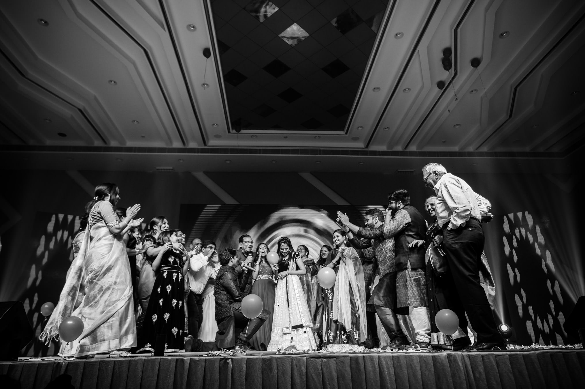 indian family enjoying the groom proposal